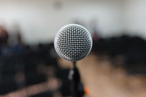 An empty microphone, that is public speaking.